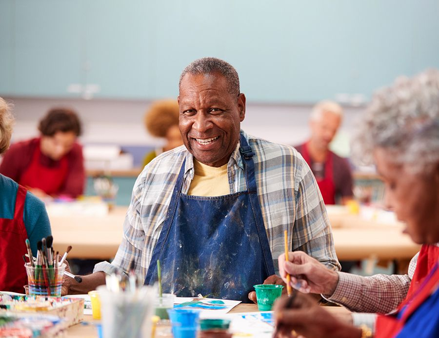 African American male, senior, smiling in art class