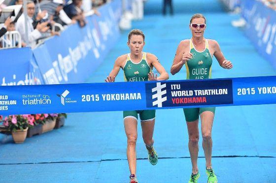Katie Kelly crossing the finish line at a 2015 Yokohama Triathlon