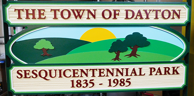GA16446 - Carved HDU Sign for the Town of Dayton's Sesquicentennial Park with Mountains, Trees, Sun and Sky Carved in Raised Relief