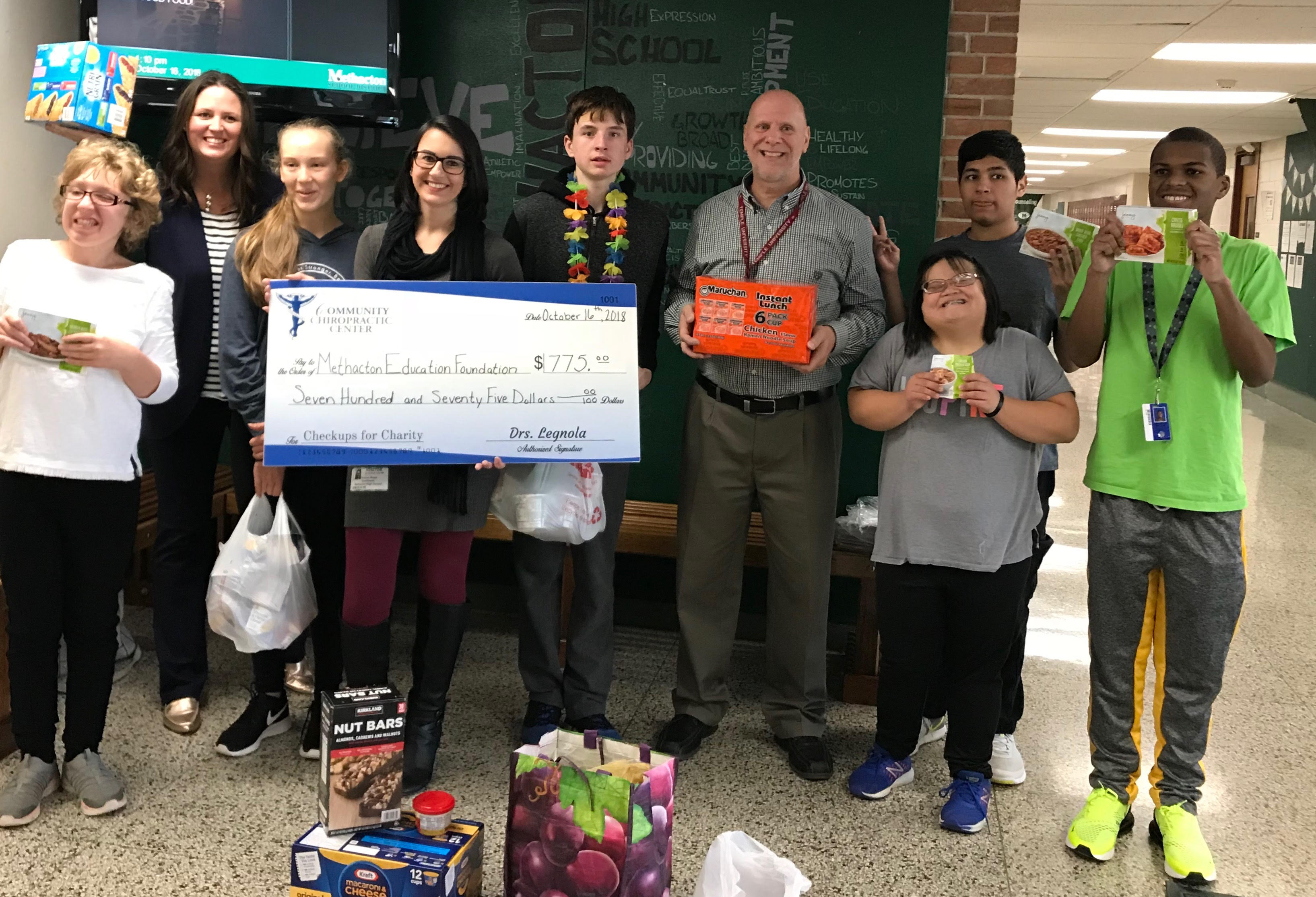 Community Chiropractic Center Donates to Backpack Program