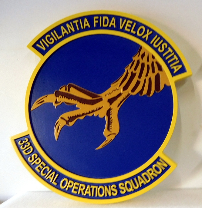 "LP-3720 - Carved Round Plaque of the Crest of the 33rd Special Operations Squadron ""Vigilantia fida velox iustitia"", Artist Painted"