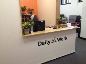Bright, cheerful Daily Work reception desk welcomes visitors