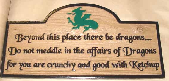 """N23185- Carved Redwood Wall Plaque Featuring a Dragon and the saying   """"Beyond this place there be Dragons...."""""""