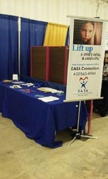 CASA Connection booth at the Colfax County Fair, in Leigh