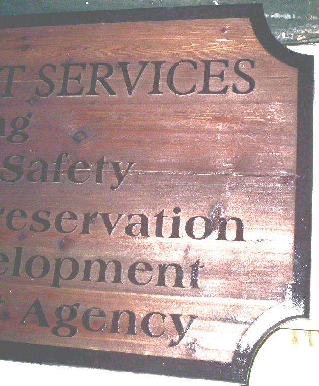F15120 - Close-up of Carved, Cedar Wood Sign for Development Services    Preservation, Economic Development and Redevelopment Agency