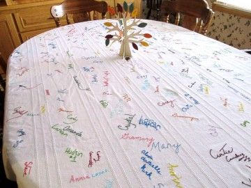 Table cloth thrifted from Goodwill covered in signatures