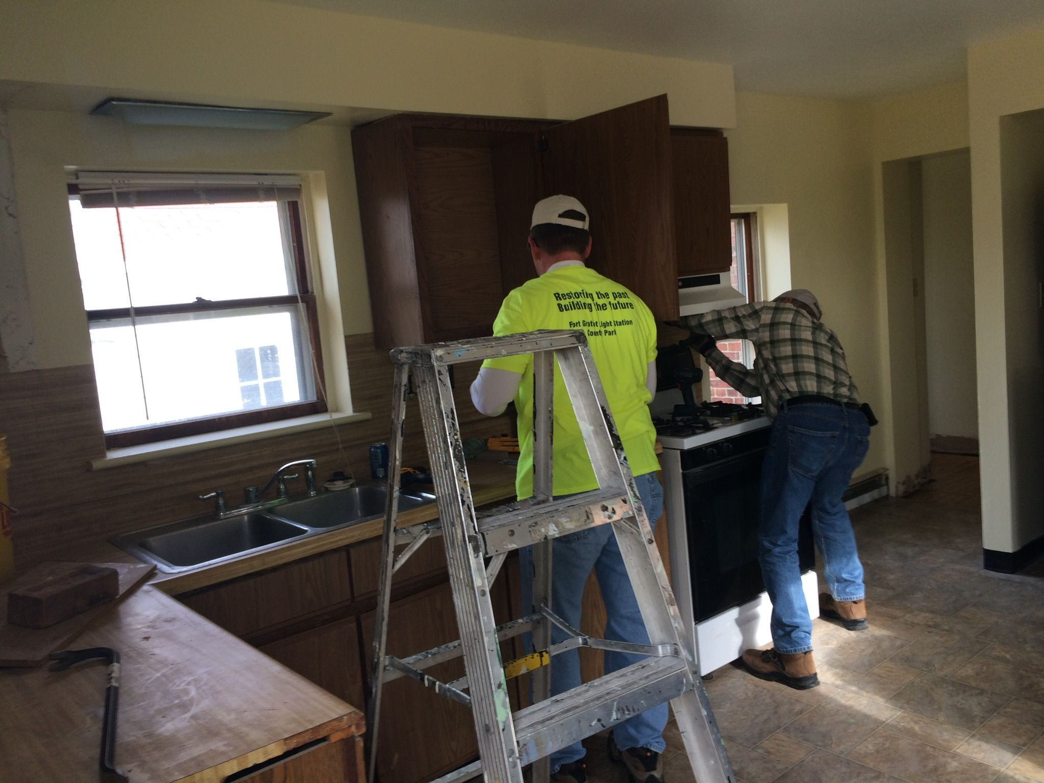 Taking out cabinets in the kitchen of the Duplex