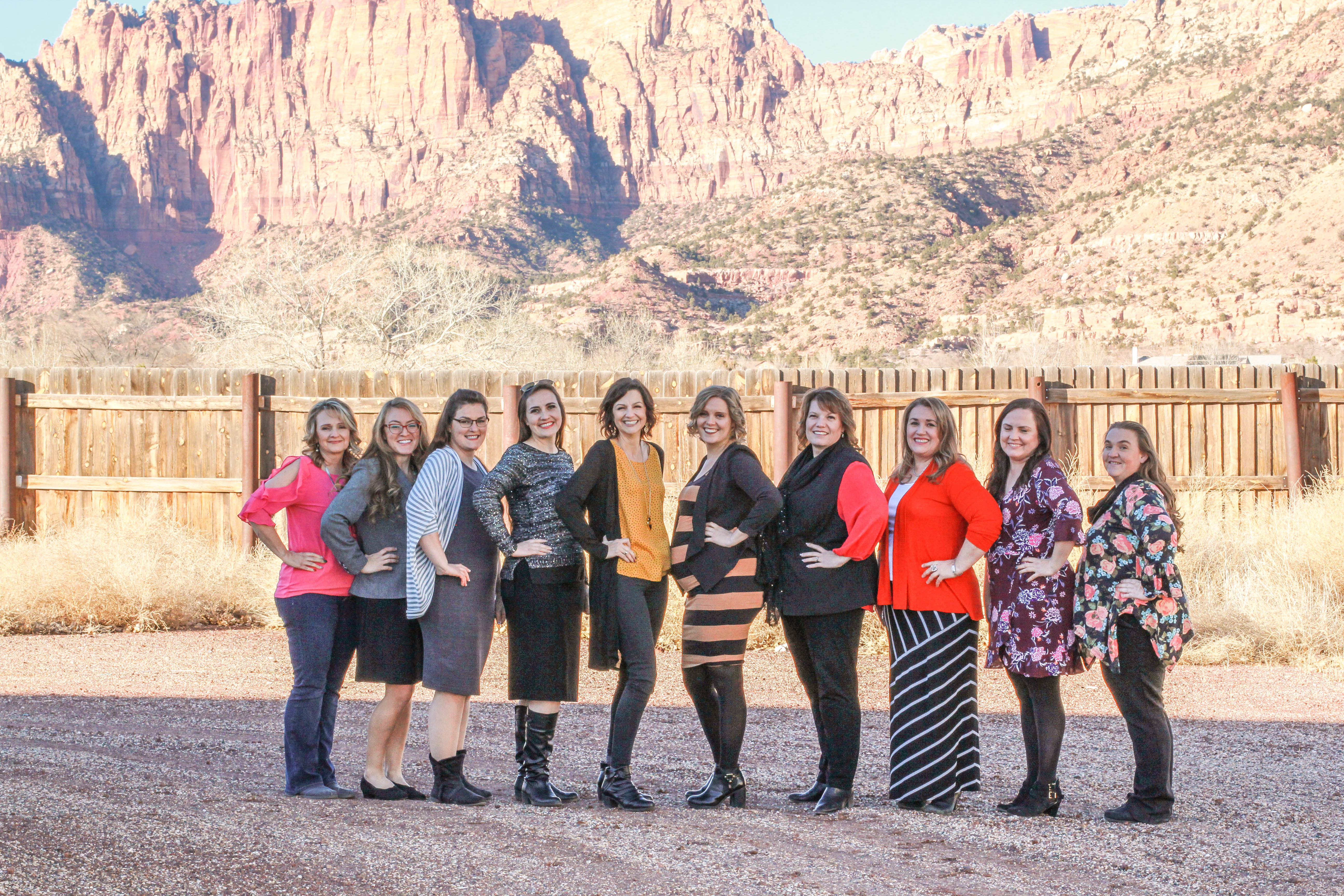 Cherish Families staff posing in front of the beautiful red mountains of Southern Utah