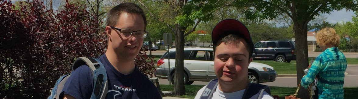 Two young men standing outside Arapahoe Community College