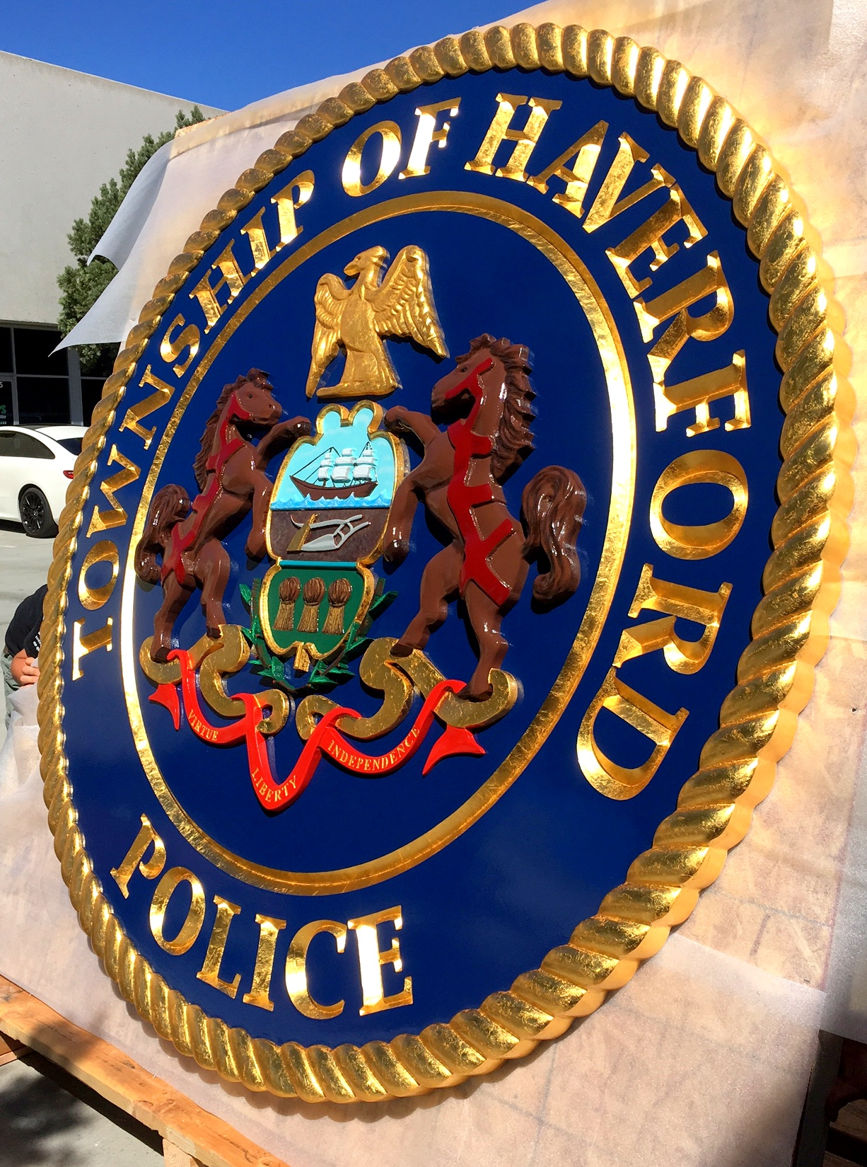 X33396 - Large  3-D  Carved  Wall plaque of the Seal  of Police Department of Haverford, Pennsylvania, with Extensive 24K Gold-leaf Gilding (Side View)