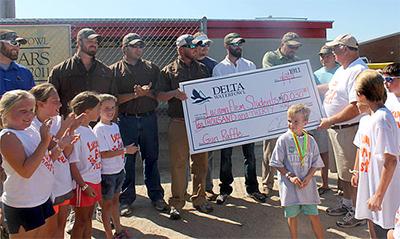 Delta Chapter Creates Stir With Gun Raffle to Aid School