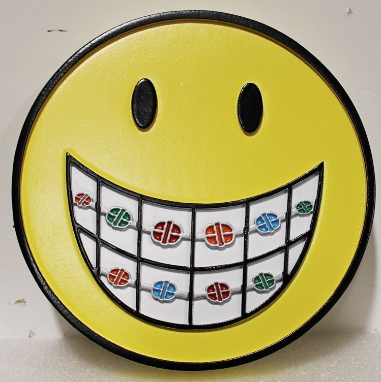 BA11648 -  Whimsical Wall Plaque of a Face with Teeth Showing Braces, made  for  a Orthodontist's  Office.
