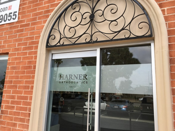 Etched vinyl window graphics for dental offices in Orange County CA