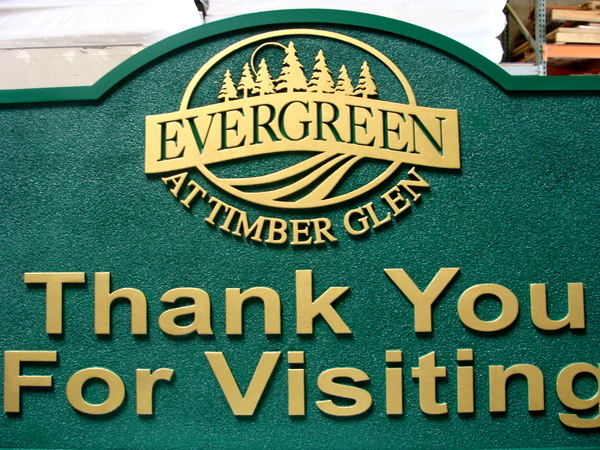 KA20632- Exit Sign for the Evergreen at Timber Glen  luxury apartments is carved in 2.5-D relief with  the Evergreen Forest Logo, Carved in 2.5-D with Sandblasted Background.