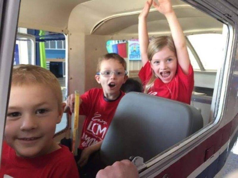 Kids playing in plane