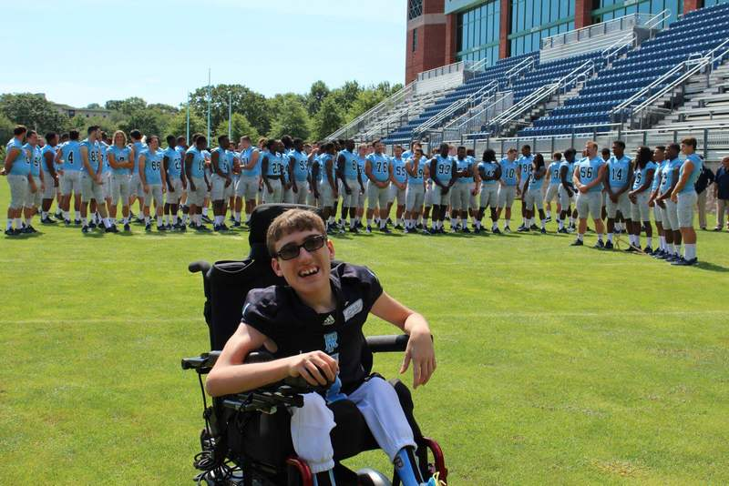 Rhode Island embraces Evan Huddon, 15-year-old with spinal defect, as member of team