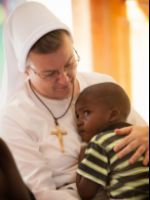 Felician Mission in Haiti - Sr. Inga with Child