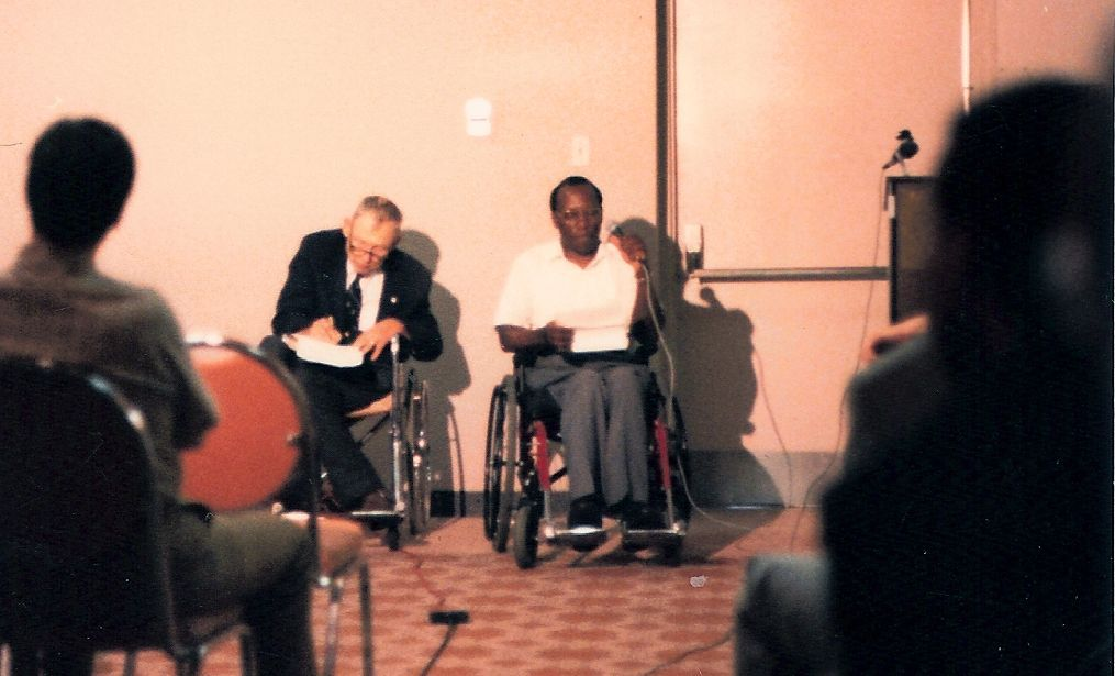 Joseph Matovu and Justin Dart (1988)
