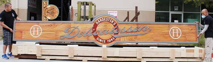 S28129 - Carved  Large High-Density-Urethane (HDU) Sign for Hardester's Deli, Painred in a Faux Wood Pattern