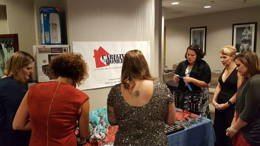 Caregivers selecting jewelry and gift bags at the Wounded Warrior Project Christmas Gala