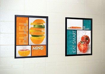 2 food posters in school hallway, food pictures, flip open frames