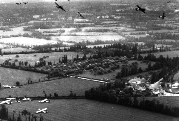 C-47s releasing gliders over a landing zone, June 6, 1944
