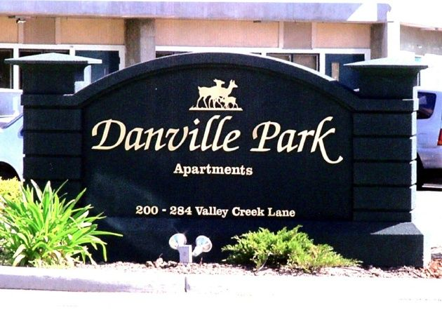 K20042 - Entrance Sign for Danville Park Apartments, Black & Gold, with Family of Deer