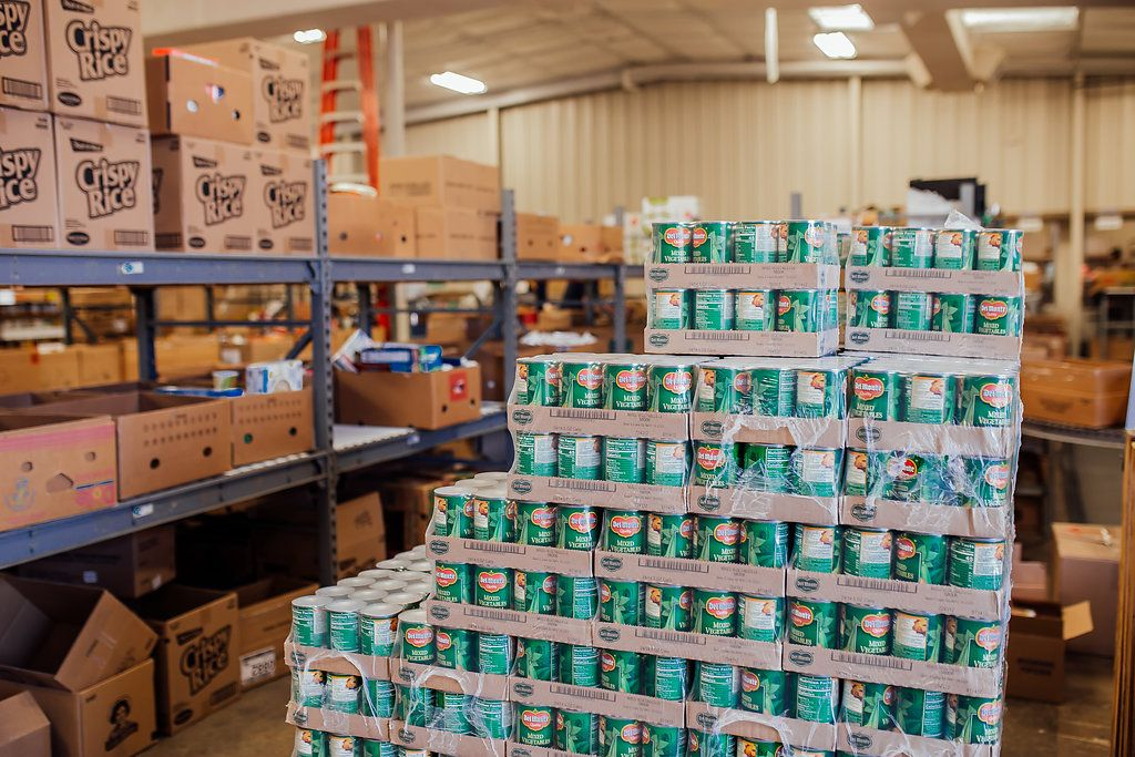 Pallet of vegetable cans.