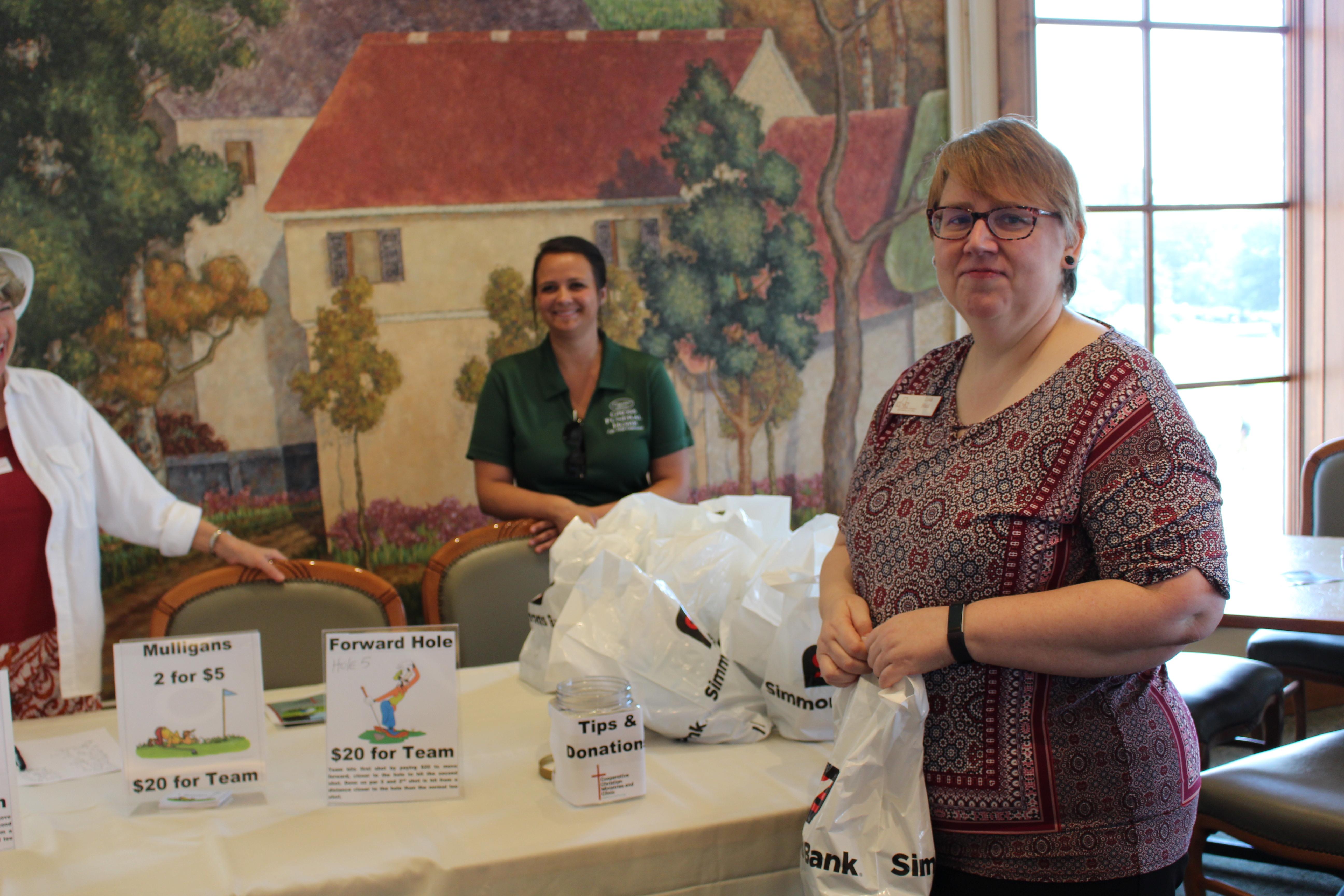CCMC Pharmacy Tech Linda Black Distributes Goodie Bags to Golfers
