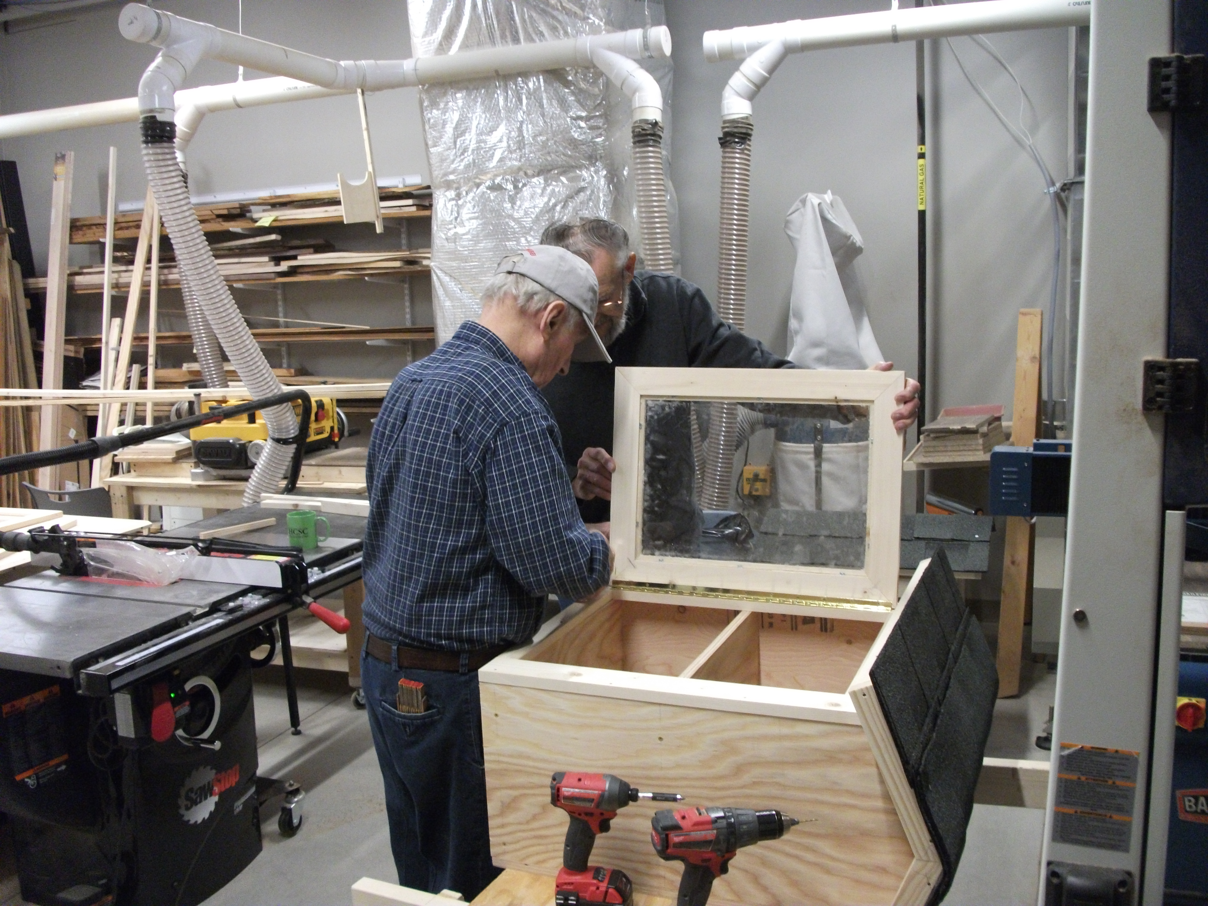 Mini Library Boxes built by the woodworking volunteers