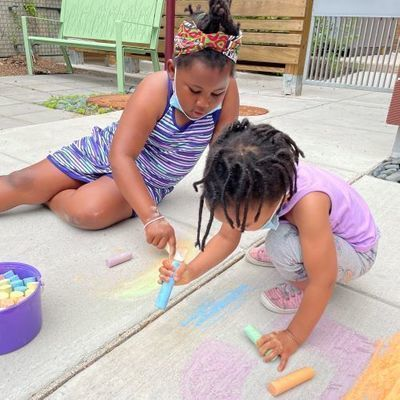 Girls drawing with chalk