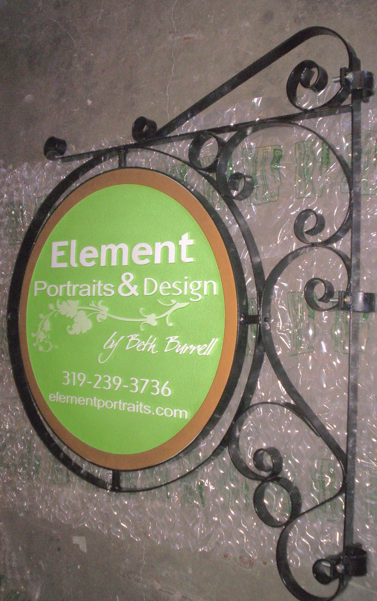 """SA28409 - Carved HDU  Sign for the """"Elements Portrait & Design""""  Studio, with Scroll Bracket for Wall Mount"""
