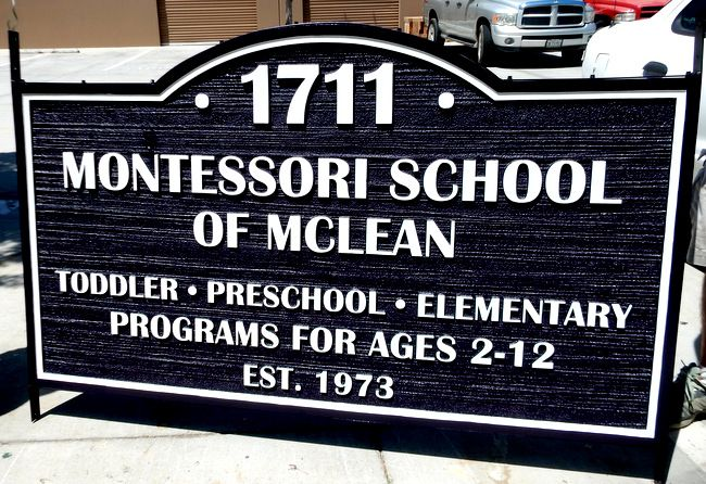 "FA15921 - Carved  and Sandblasted Wood Grain HDU Entrance Sign for the ""Montessori School of McClean"", 2.5-D  Raised Relief,"