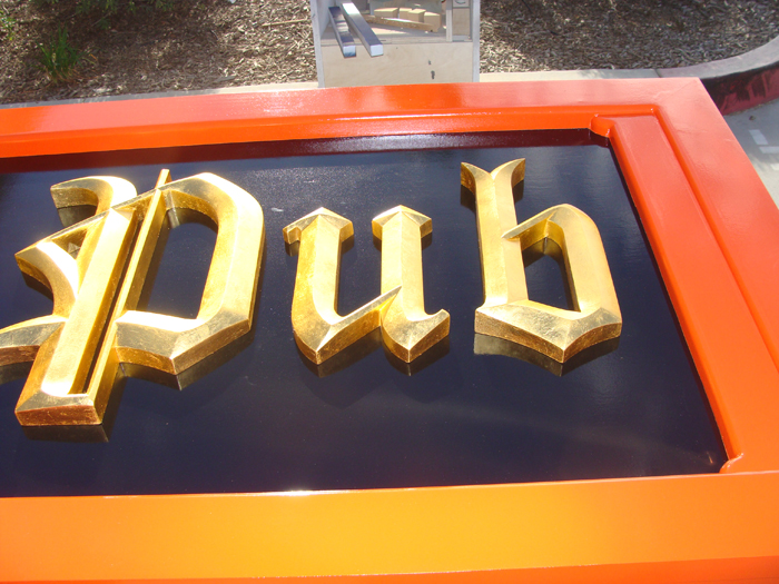 RB27512 - Close-up of Irish Pub Sign with Gold Carved Letters