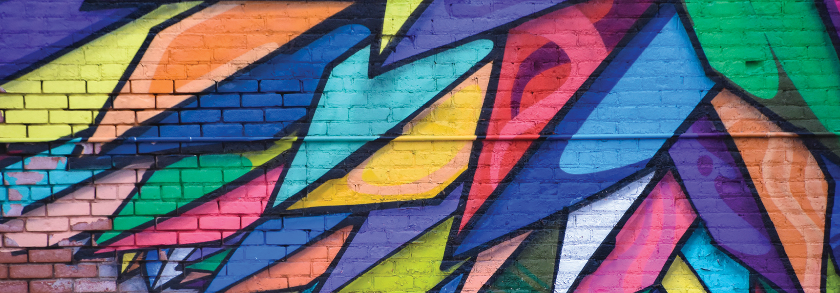 Brightly colored feather design on wall for background art
