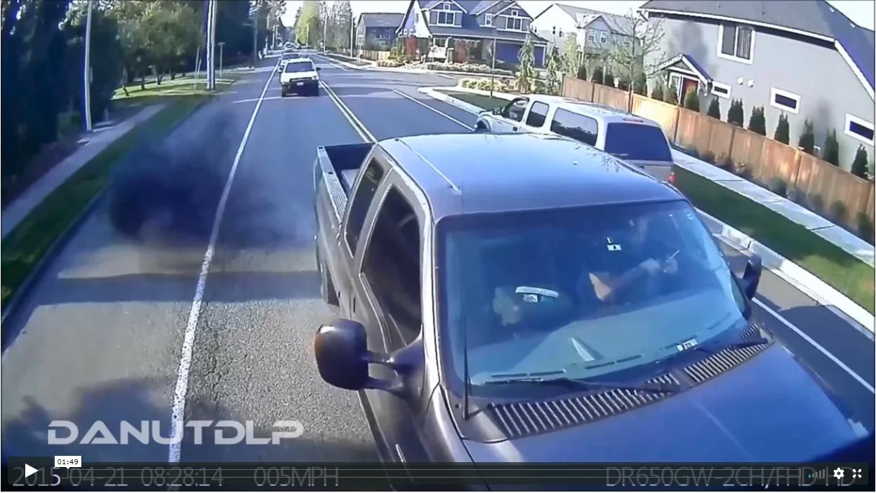 Distracted Driver Using Phone Hits Back of Van