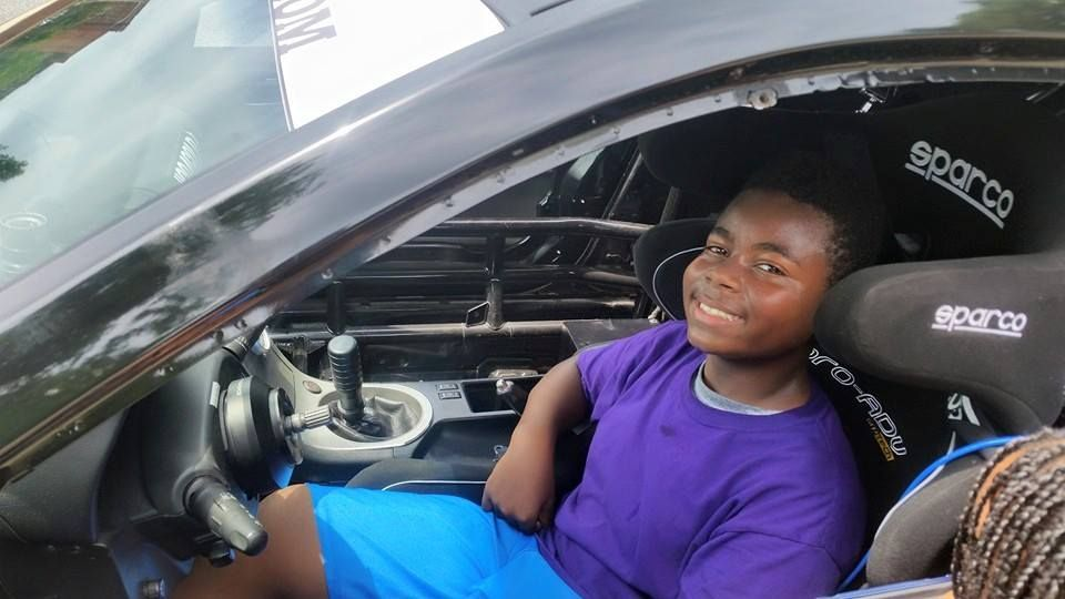 Esaiah enjoying the race car visit