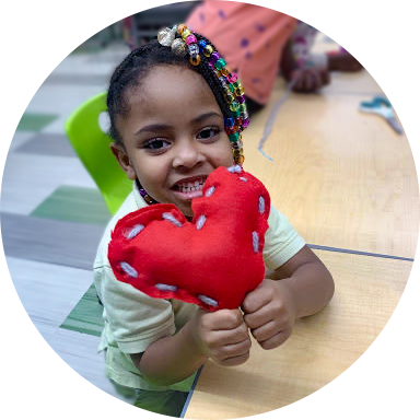 mikayla smiling with heart pillow