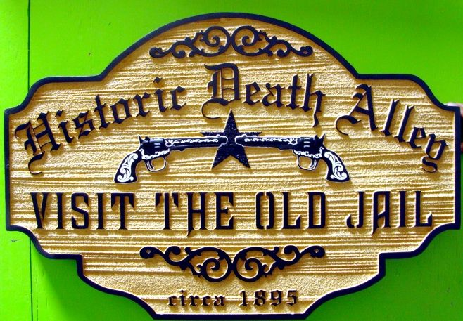 F15995 - Sandblasted, Carved, Wood Look HDU Sign for Historic Old Jail with Carved Sheriff's Star and Guns