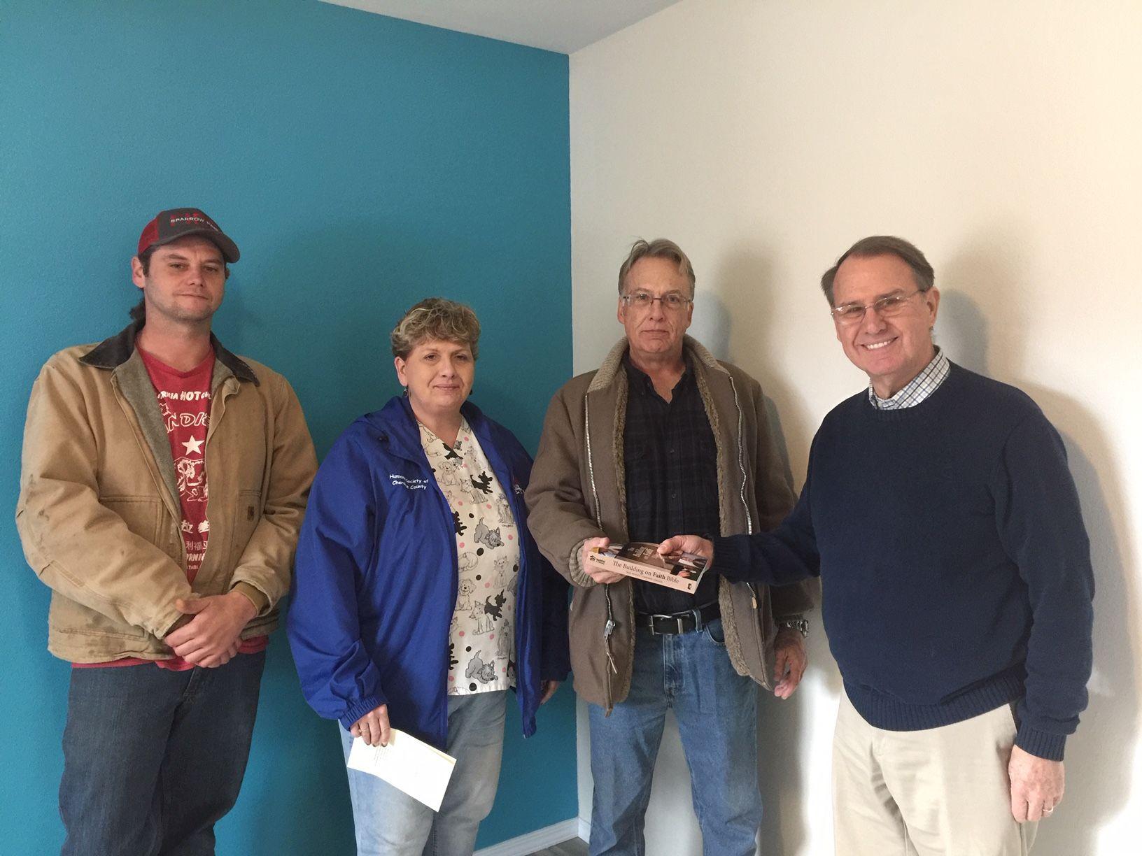 House Blessing for House #27. Photo Left-Right: Russell Martin, Kathy Vanschuyver, homeowner Ben Vanschuyver, Rev. George Warren