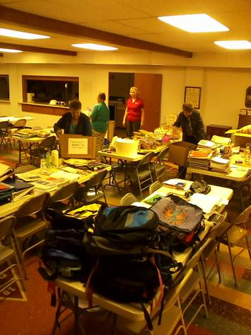 Sorting donated school supplies.