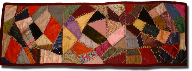 Crazy table runner, maker unknown, made in United States, circa 1880-1900, 63 x 22 in, IQSCM 1997.007.0956