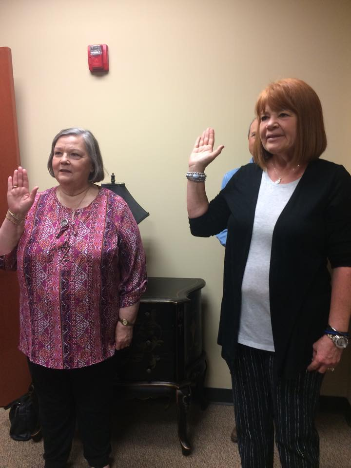 Lois and Barbara taking the Volunteer Oath