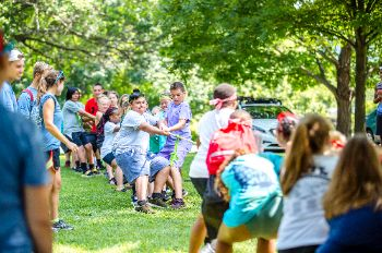 Campers play tug-of-war.