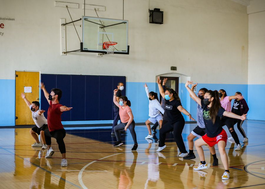 Raul teaches dance moves to participating youth.