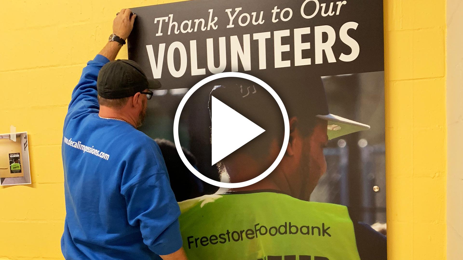 Liberty Street Market Volunteer Board Install