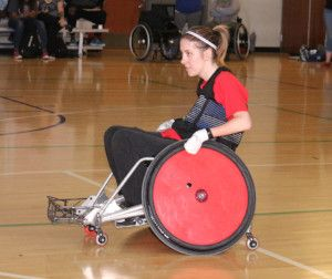 Candice Minear in her KC Revolution Rugby uniform and wheelchair