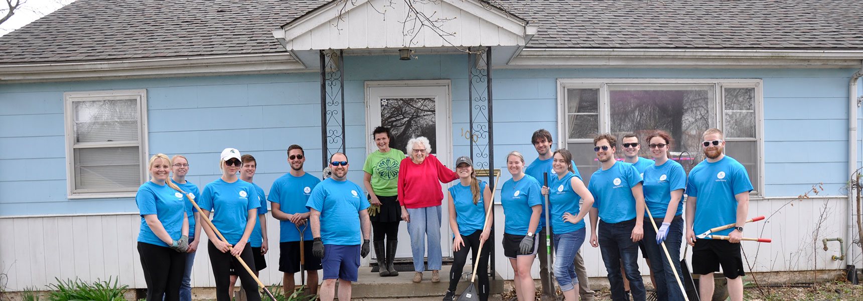 Group of volunteers at Planting Independence standing with homeowner