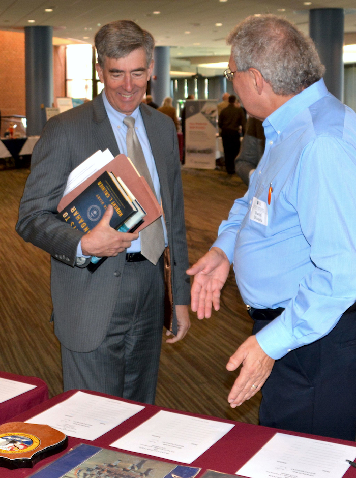 NCMF BoD Chairman Chris Inglis and NCMF Acquisitions Committee Chairman Dave D'Auria at the Silent Auction tables.