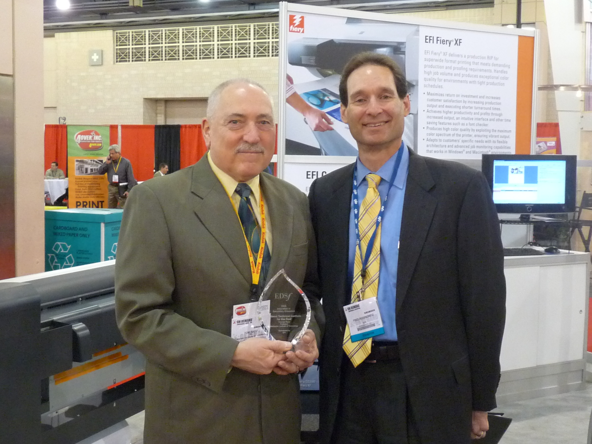 Thomas Raco, RIT, accepts the 2009 Innovation in Secondary Education Award from Fred Rosenzweig, EFI
